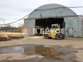 трактор для транспортировки бревна