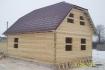 брусовой дом с верандой и просторной мансардой