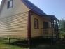 угол построенного дома с мансардой