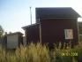 задняя сторона дома с одним окном