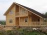 общий вид двухэтажного деревянного дома